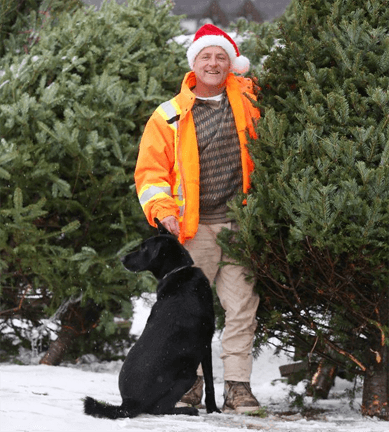 Fallowfield Tree Farms owner, Kenyy Stuyt and his best friend, choosing a Christmas tree