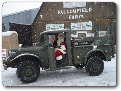 Photo of Santa arriving at Fallowfield Christmas Tree Farm in an old jeepy truck
