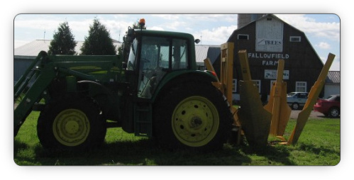 Ottawa Fallowfield Tree Farm tree scoop and bucket tractor of tree transplanting, moving and removal - 613-720-3451